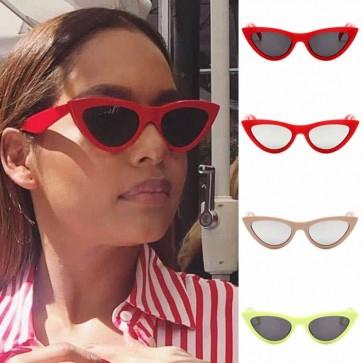 Exaggerated cat-eye sunglasses retro feel tailored look
