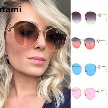 Geometric cat-eye sunglasses retro feel tailored look