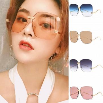 Metal-tipped bridge sleek oversized rimless sunglasses