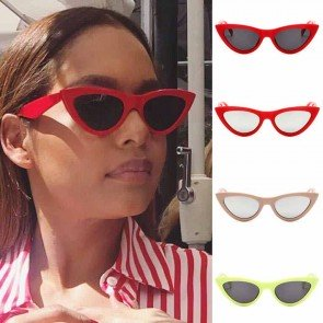Exaggerated cat-eye sunglasses retro feel tailored look