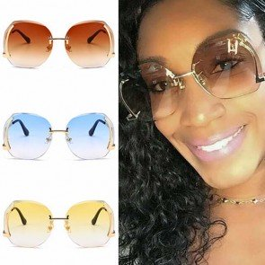 Modern oversize rimless sunglasses curved temples