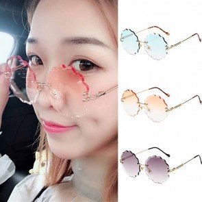 Modern curved arms sleek cute rimless round sunglasses
