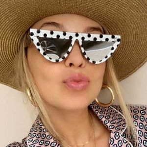 Flat top cat eye horned rim dome shaped sunglasses